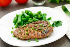 Beef steak with green beans Stock Photos