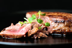 Beef steak with greens Stock Photography