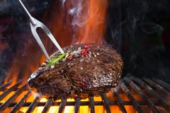 Beef steak on grill Royalty Free Stock Photos