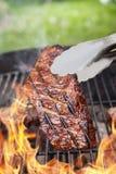 Beef steak on grill Stock Photo