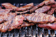 Beef steak on grill. Flame broiled beef steak on grill stock image