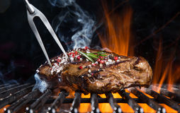Beef steak on the grill. Grilled beef steak on the grill, close-up royalty free stock image