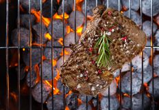 Beef steak on grill Stock Photography