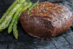 Beef steak grilled with asparagus, tomatoes, spice. A royalty free stock image