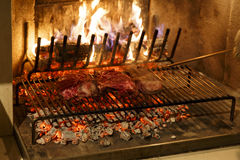 Beef steak grilled. A top sirloin steak flame broiled on a barbecue, shallow depth of field stock photo