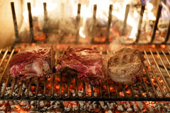 Beef steak grilled. A top sirloin steak flame broiled on a barbecue, shallow depth of field stock photos