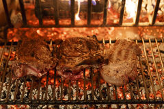 Beef steak grilled. A top sirloin steak flame broiled on a barbecue, shallow depth of field royalty free stock image