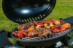 Beef steak and grilled vegetables in nature stock photos