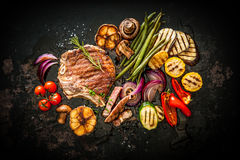 Beef steak with grilled vegetables Stock Images