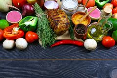 Beef steak with grilled vegetables and seasoning on wooden board. menu restaurant. top flat view. Food background. Black text area royalty free stock photos