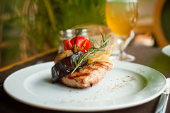 Beef steak with grilled vegetables. Well done beef steak with grilled vegetables and rosemary Royalty Free Stock Photos