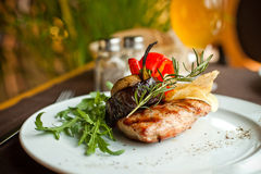 Beef steak with grilled vegetables. Well done beef steak with grilled vegetables and rosemary Stock Image