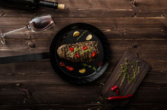 Beef steak with herbs and chilli, product photo. With wine for client Stock Photos