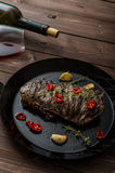Beef steak with herbs and chilli, product photo. With wine for client Royalty Free Stock Photo