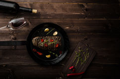 Beef steak with herbs and chilli, product photo. With wine for client Stock Photo
