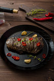 Beef steak with herbs and chilli, product photo. With wine for client Royalty Free Stock Photography