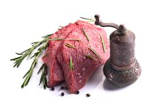 Beef steak  isolated on white background. Beef steak with old copper pepper mill isolated on a white background Stock Photo