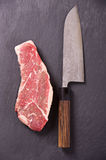 Beef Steak with Japanese Santoku Knife Royalty Free Stock Photography