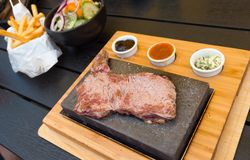 Beef steak on lava stone royalty free stock photos