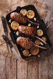 Beef steak with lemon on a grill pan. vertical top view Stock Photography