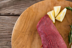 Beef steak, lemon and rosemary herb on wooden tray stock images