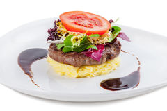 Beef steak with mashed potato and tomatoes. Beef steak with mashed potato, and tomatoes on a white plate royalty free stock photos