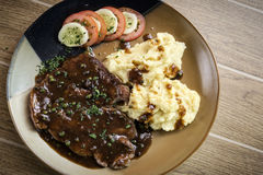 Beef steak meal with mashed potato and gravy sauce Royalty Free Stock Image
