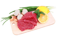Beef steak on meat hardboard with mushroom and l. Emon. Isolated stock image