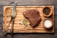 Beef steak medium. On the board for steaks royalty free stock photography