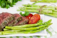 Beef steak medium roast with asparagus Stock Photos