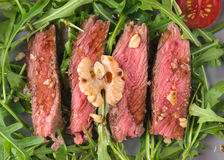 Beef steak medium on Roccola leaves Royalty Free Stock Photography