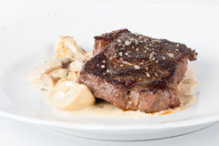 Beef steak with mushrooms. Rib steak with sauteed mushrooms and onions, french fries and vegetables Stock Photography