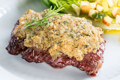 Beef steak with mustard herb crust and romaine lettuce hearts wi Stock Image