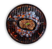 Beef steak in pan served on grill Stock Photo
