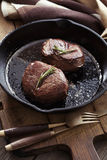Beef steak in pan Royalty Free Stock Images