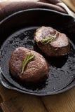 Beef steak in pan royalty free stock photos