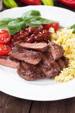 Beef steak with pasta and red beans Stock Photo