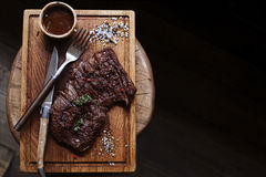 Beef steak. Piece of Grilled BBQ beef marinated in spices - Stoc Royalty Free Stock Images