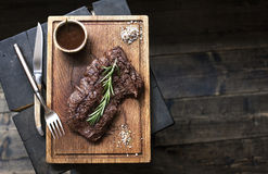 Beef steak. Piece of Grilled BBQ beef in spices Royalty Free Stock Photos