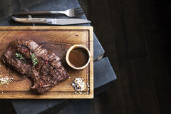 Beef steak. Piece of Grilled BBQ beef in spices Stock Images