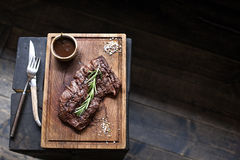 Beef steak. Piece of Grilled BBQ beef in spices Royalty Free Stock Photography
