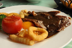 Beef steak in the plate. Close up of beef steak in the plate Royalty Free Stock Photo