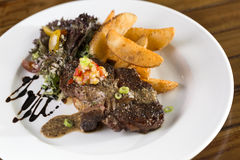 Beef Steak. A plate of beef steak to be served with fries and salad Royalty Free Stock Images