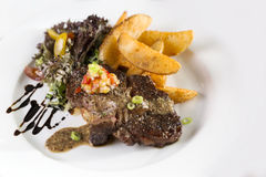 Beef Steak. A plate of beef steak to be served with fries and salad Royalty Free Stock Photos