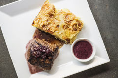 Beef steak with potato and cheese bake Royalty Free Stock Images