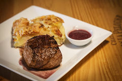 Beef steak with potato and cheese bake Royalty Free Stock Photo