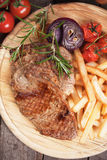 Beef steak with potato and vegetables Stock Images