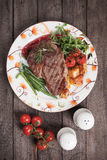 Beef steak with potato and vegetables Stock Photography