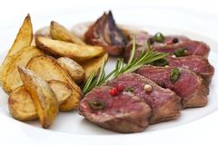 Beef steak and potatoes Stock Photography