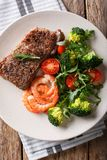 Beef steak with prawns and broccoli, tomatoes, arugula closeup o stock photography